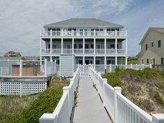 Looking for a luxurious getaway to Emerald Isle? A Gathering Place is a platinum-rated, 8 bedroom, 8.5 bathroom oceanfront cottage with its own private swimming pool, hot tub, and covered gazebo.