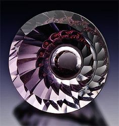 Kazuhito Komatsu / Second Place  Laurel Crown Cutting / 19.5mm round. Natural pink amethyst, concave cutting. 25.35 carats