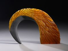 "Alex Bernstein ""Amber Arch""  cast, cut glass, fused steelhttp://www.morganglassgallery.com/imagepages/amber-arch.htm"