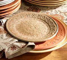 embroidered fabric pattern on terra-cotta plates