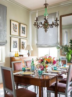 Stunning traditional dining room with velvet Louis side chairs, antique brass chandelier and neutral accents.