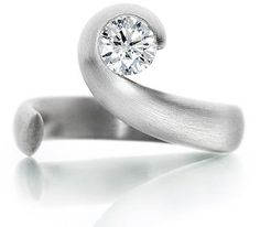"Platinum single stone round brilliant cut diamond ""Wave"" design ring. £5867 (available with polished or brushed finish)    Jewellery Designer of the Year - multiple award winner.    Catalogue Number 260536"
