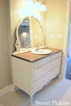 Dresser made into bathroom vanity; I would put the sink either to the right or left so you only loose use of one of the top draws instead of both.