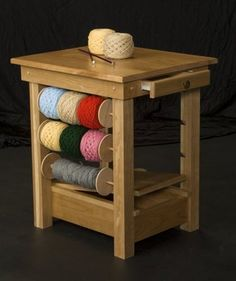 Collins Solid Cherry Wood Knitting / Crochet Table - removable spindles for yarn, small drawer for notions, and hollow bottom area for larger things. Table has edges for attaching yarn winders and swifts. Crochet Tools, Crochet Yarn, Diy Yarn Holder, Yarn Organization, Yarn Storage, Spinning Yarn, Spinning Wheels, Yarn Bowl, Household Items