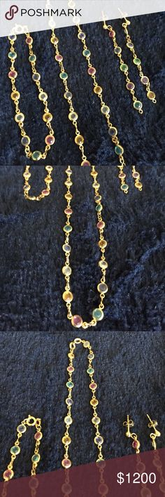 """18k solid God set with different gemstones GORGEOU Worn once very few made by a jewelry artist several years ago but I wore it once, not really my still, it has bee sitting in my closet for years and someone who really loves it can show the beauty of such piece of work. This piece is solid 18k not 14 and beside being exclusive and very few being made is very rare. Have not seen anything close to it. Engulfed yourself today with a treasured piece. Necklace length 18"""", bracelet length 7"""" and…"""