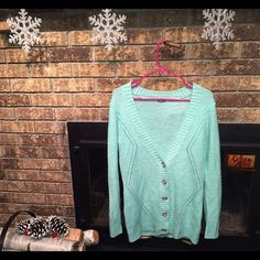 NWOT mint colored slightly oversized knit cardigan Absolutely adorable mint colored knit cardigan! Super comfy and adds a pop of color to any wardrobe, definitely a must have in my opinion! Purchased 2 winters ago I believe and it's just been sitting in my closet since because I have another cardigan that's very similar. Never been worn and only tried on twice, in perfect condition!! Charlotte Russe Sweaters Cardigans