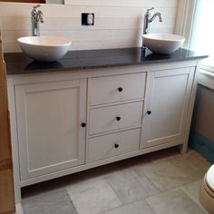 IKEA hack: this black and white master vanity features a hemnes sideboard cabinet converted into a budget-friendly dual sink vanity- complete with black granite top custom made from a salvaged remnant.