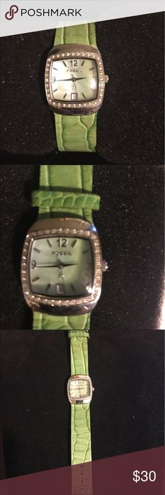 Beautiful leather Fossil Watch Women's Fossil Watch. Green Leather band that's in perfect condition. Stainless Silver face with crystal jewels wrapping around. No scratches on face. Excellent condition. Has a new battery. Works great Fossil Accessories Watches