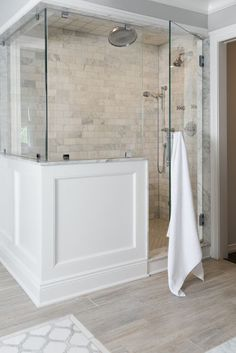 Like the shower tile. Organic and soft. Fall in love with this Boll & Branch White Bath Sheet. #bollandbranch Bathroom Wainscotting, Wood Tile Bathroom Floor, Wood Tile Shower, White Tile Shower, Wood Look Tile Floor, Farm House Bathroom, Glass Shower Doors, Glass Bathroom Door, Neutral Bathroom Tile