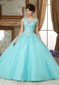 Full of amazing details, you'll look like a beautiful Princess wearing Mori Lee Mori Lee Valencia Quinceanera Dress Style 60006 at your Sweet 15 party. Made out of lace and tulle, this ball gown features a cap sleeve lace bodice decorated with crystal beading, sheer illusion neckline, long A-line skirt, and a lace-up corset back. A matching stole is included. Colors: Aqua, Scarlet Red, Blush, White Please allow 4 - 5 months for delivery because Mori Lee Valencia Quinceanera dresses are ...