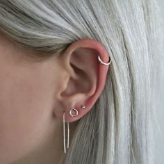 Silver jewelery – silver hair – earparty – earrings # ear party # earrings – Ohrringe, You can collect images you discovered organize them, add your own ideas to your collections and share with other people. Piercing Implant, Piercing Rook, Cute Ear Piercings, Triple Lobe Piercing, Conch Piercings, Unique Piercings, Ear Jewelry, Cute Jewelry, Jewelery