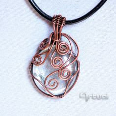 Copper wire wrapped glass pendant.