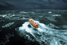 A lifeboat negotiates stormy conditions off Ile d'Ouessant in Brittany, France - Photograph: Phillip & Guillaume Plisson /Rex Features