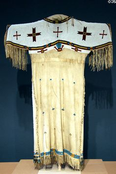 Lakota Sioux deerskin dress with beadwork  feather decoration (c1880) at Denver Art Museum. Denver, CO.