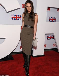 Victoria Beckham is the picture of elegance in a clinging dress ...