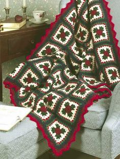 Christmas Granny Afghan. I'd use different colors (a cream instead of the true white, and a chocolate brown instead of the navy blue), and eliminate the decorative edging. Probably good yarn. This would be something that made a special appearance for a couple of months during the holiday season.