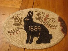 black rabbit rug, perfectly prim.....design by Goos Nest, hooked by My Glory stars
