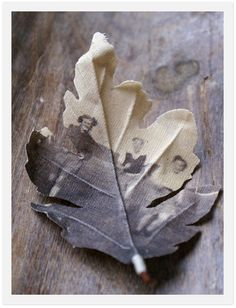 these leaves are created by imprinting digitized images on unbleached cotton. Their tactile, faded quality is part of their charm - they remind me of sentimental flowers pressed in old book. Fragile yet precious.