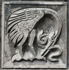 Old bas-relief of fairytale heron and snake — Stock Photo #5763610