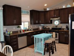 espresso cabinets / love the little table as island!