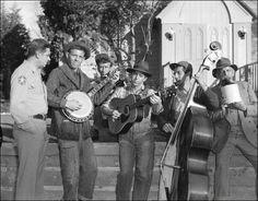"""Andy Griffith with the Darlings.  """"The boys are all keyed up today, sheriff."""""""