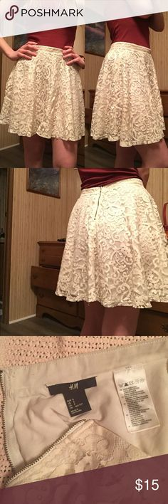 White lace skirt Beautiful ivory Lacey skirt. Zipper closure on the back. Comfy and a great length to feel covered and cute! Worn a bit but in great condition! H&M Skirts A-Line or Full