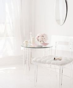 There is such a marvelous sense of lightness and tranquil beauty to this white, lucite and pale pink room.
