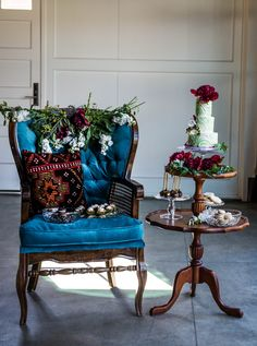 Moody jewel toned wedding dessert display with vintage chair and bohemian Turkish pillow. Rentals by Birch & Brass Vintage Rentals at @Union On Eighth in Georgetown, TX.
