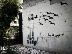 """Our hearts will not migrate""  Homs"