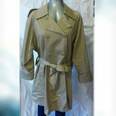 Worthington trench coat Worthington trench coat Tan Made in Poland  Excellent condition like new  Measurements laying flat Length 36.5in Chest 22in. Sleeve 16in.  Material content Shell: 52% cotton 48% polyester Lining: 100% nylon Worthington Jackets & Coats Trench Coats