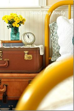 yellow bed frame, vintage suitcase end table/nightstands
