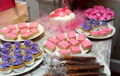Ballerina Baby Shower dessert table:  sugar cookie bars, chocolate covered pretzels, mini cupcakes, and pink meringue cookies.
