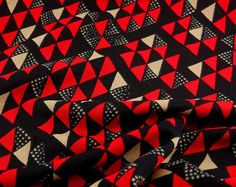 Vintage Geometric Fabric. Triangle Chevron Pattern. Eighties Punk Style. Red Black White 64 inches x 36 inches. $10.00, via Etsy.