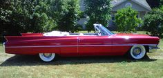 Our get away car- 1964 Cadillac DeVille convertible. Candy apple red, all white interior. Harry's childhood car!