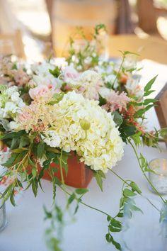 love this floral arrangement, photo by Emily Heizer, flowers by Art in Bloom http://ruffledblog.com/woodsy-sierra-nevada-wedding #flowers #centerpieces