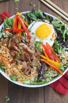 Korean Bulgogi Bowls are packed with flavor and absolutely delicious! Simple marinated pork served over kimchi fried rice with leafy greens and a fried egg on top. This dish is better than take-out, and easy to make from home! Pork Recipes, Asian Recipes, Ethnic Recipes, Recipies, Quick Recipes, Free Recipes, Korean Bulgogi, Korean Dishes, Korean Food