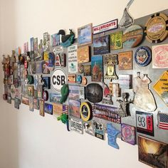 "souvenir magnet display board"" - collection of magnets from places"