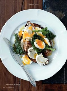 toast with goat cheese, kale, and soft boiled eggs topped with lemon and salt