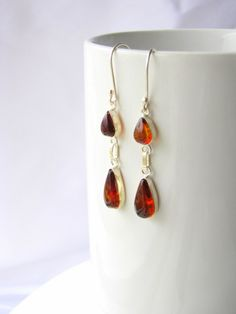 Red amber & silver earrings. Unique and original. Red amber is a rare gemstone only found in a deposit in Chiapas, Mexico. www.chiapasbazaar.com