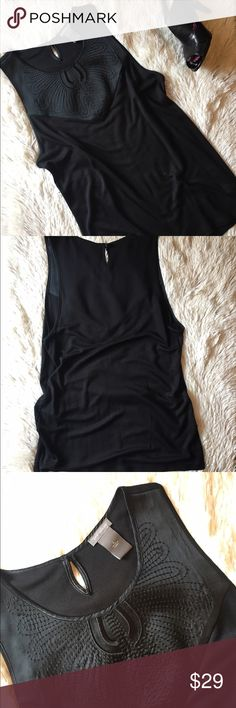 Ann Taylor black sleeveless top New without tag. Ann Taylor black sleeveless top. Size L. Body 100% modal, chest 70% silk, 30% nylon. Measurements pictured. Ann Taylor Tops Blouses