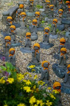 """Jizo is a Japanese god who's thought to protect children who die before their parents. There more than one million small Jizo statues spread throughout Japan at temples or along the side of roads. The Japanese care for these statues — giving them hats and bibs."""