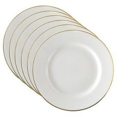 Porcelain dinner plate with gold-hued trim. Product: Dinner plateConstruction Material: PorcelainColor: White and goldFeatures: Gold line edgeDimensions: 10.25 DiameterCleaning and Care: Safe for use in microwave, dishwasher and freezer