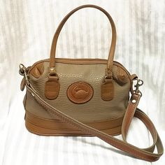 100% authentic Dooney & Bourke satchel/cross body Pebbled leather exterior in excellent condition. Removable crossbody/shoulder strap. Plastic interior is cracked & torn in multiple places. Dooney & Bourke Bags