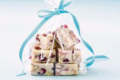 Cranberries and orange zest add unexpected flavor to this tasty white chocolate fudge.