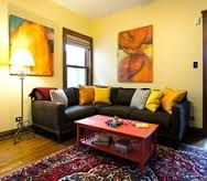 Image result for living room yellow walls red rug