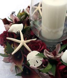 center piece for a beach wedding- These flowers look hideous with this, but I like the idea.