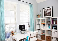 blue/grey office with green/aqua window hints- accented with white