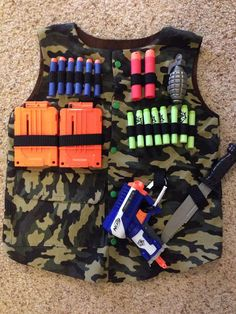 Nerf tactical vest made to order. Sizes 4, 6, 8, and 10. Does not include darts, magazines or accessories. Listing is for handmade vest only. The