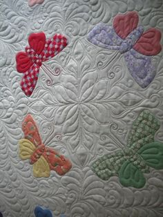 Butterfly Quilt I really like how the appliques were quilted. Look at designing someone similar with the flower applique quilt