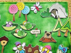 check out this cute #fairy #playmat! It's made using printables...my kind of easy! Love the lollipop forest and the pea pod baby nursery. Mr. Wolf changes hiding locations every day! The kids can arrange this a zillion ways!